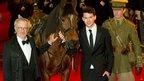 Director Steven Spielberg, actor Jeremy Irvine, Joey the horse and his handler