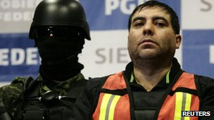 Suspect Felipe Cabrera Sarabia (right) is presented to the media in Mexico City in this 26 December 2011 file photo.