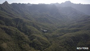 Military helicopter flies over marijuana plantations in the mountains of Sinaloa, December 2011