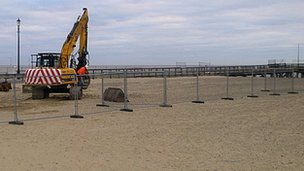 Digger at Great Yarmouth jetty