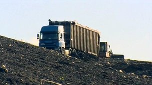 Lorry driving up to rubbish tip