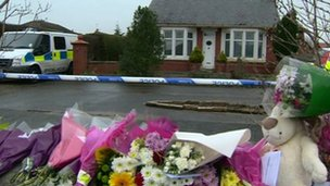 Floral tributes outside the house in Freckleton