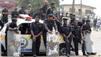 Police watch protesters in Lagos