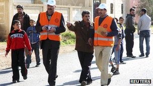 Arab League observers in -Msefra town near Deraa, southern Syria, 5 January