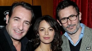 Michel Hazanavicius (r) with The Artist stars Jean Dujardin and Berenice Bejo
