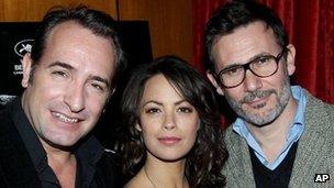 Michel Hazanavicius (r) with The Artist stars Jean Dujardin and Berenice Bejo
