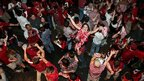 Alabama fans celebrate their victory over LSU on Bourbon Street in the French Quarter of New Orleans on Monday