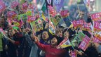 Supporters of Taiwan&#039;s main opposition Democratic Progressive Party (DPP) presidential candidate Tsai Ing-wen wave flags as they wait for Tsai&#039;s campaign in Taichung on Tuesday