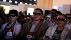 Attendees at a Sony press event watch while wearing 3D glasses