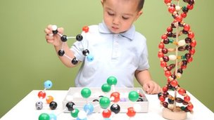 Boy building molecular structures
