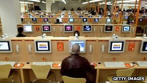 Users in an internet cafe in Times Square, New York