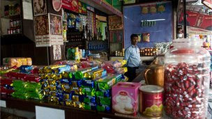 An Indian shopkeeper in his store