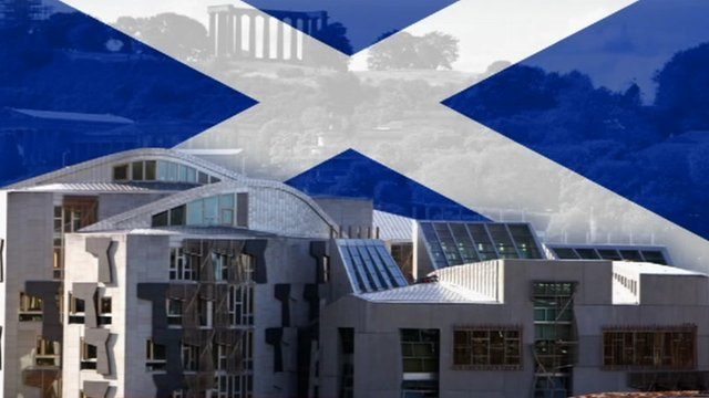 Scottish Parliament with graphic of saltire behind
