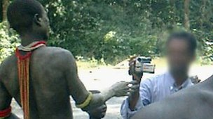 A tourist films Jarawa on the Andaman Trunk Road (Photo courtesy: Survival International)