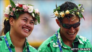 two athletes laughing