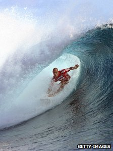 An athlete performs at a surf event in Tahiti