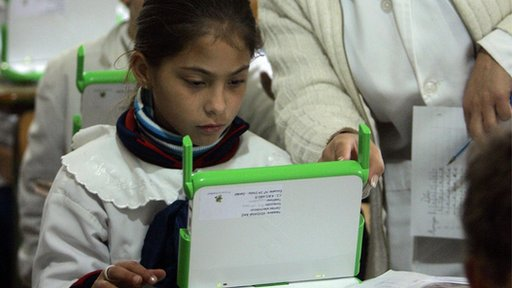 "A student learns how to use ""hundred-dollar"" laptop computers given them days earlier by the One Laptop Per Child (OLPC) project"