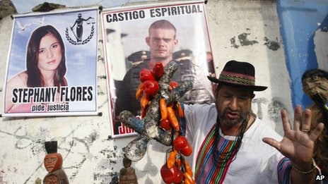 A shaman performs a ritual for the spiritual punishment of Joran van der Sloot, and for justice for Stephany Flores, in poster at left, as the murder trial gets underway (6 Jan 2012)