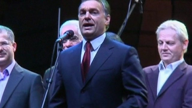 Hungarian Prime Minister, Viktor Orban speaks at a microphone.