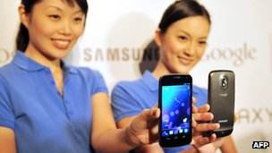 Models holding Samsung Galaxy Nexus phones
