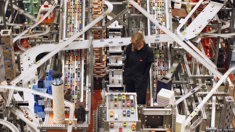 Alison Walker watches over Chris Burden's large-scale kinetic sculpture, Metropolis II