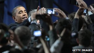 President Barack Obama greets supporters at a rally to help raise money for his re-election campaign 11 January 2012