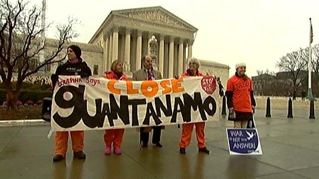Protesters demanding the closure of Guantanamo