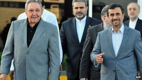 Cuban President Raul Castro (L) and Iranian President Mahmoud Ahmadinejad walk at Jose Marti airport, on 12 January before the latter&#039;s departure from Cuba