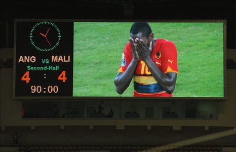 Angola's Zuela reacts with disbelief after teh final whistle in Luanda