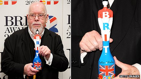 Sir Peter Blake holds his design for the 2012 Brit Award