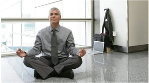 Airport man in yoga pose