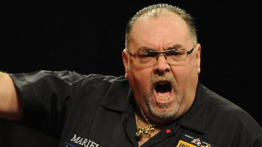 Tony O'Shea celebrates beating BDO world champion Martin Adams