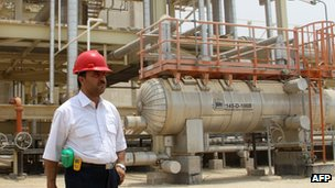 An Iranian worker stands in front of  the South Pars gas field