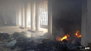 Fire rises at the Benin Central Mosque after an attack by youths on 10 January 2012