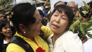 A political prisoner, right, is welcomed by friends as she comes out of Insein prison in Rangoon, Burma, on Friday 13 January 2012