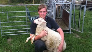 Adam Arnesson with one of his sheep
