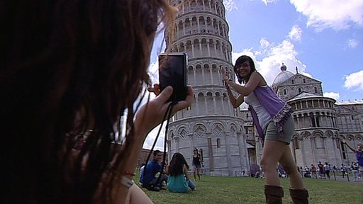 Taking a photo by the Leaning Tower of Pisa