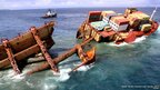 MV Rena is seen in two pieces as the stern falls off Astrolabe Reef in Tauranga, New Zealand