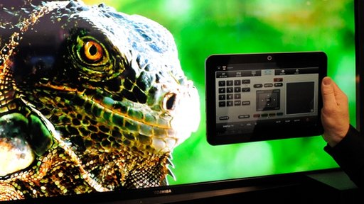 A Toshiba Excite EX10 Android tablet running the Tablet Remote App Capable (TRAC) technology is displayed in front of a Toshiba 55-inch L7200 Series TV at the 2012 International Consumer Electronics Show