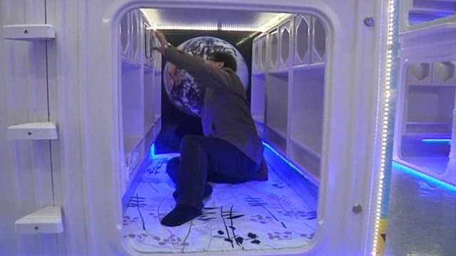 Student tests sleep pod in Hong Kong