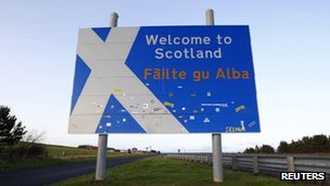 "A ""Welcome to Scotland"" sign is seen at the border near Berwick-upon-Tweed in northern England"