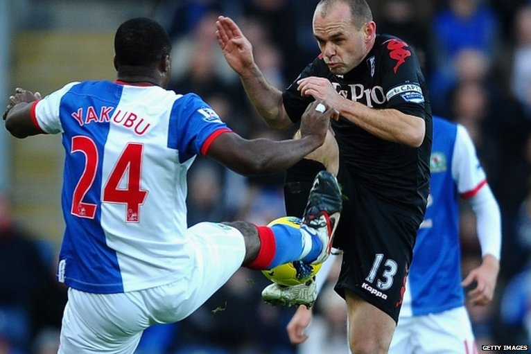 Blackburn's Yakubu tackles Fulham's Danny Murphy