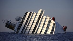 The luxury cruise ship Costa Concordia lays on its side after running Giglio island, Italy, 14 January