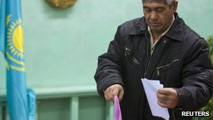 man casts his ballot in the village of Kosmos, east of Almaty. Photo: 15 January 2012