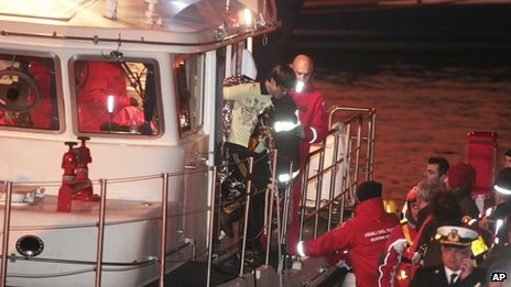 South Korean man is brought ashore after being rescued from Costa Concordia, 15 Jan 2012