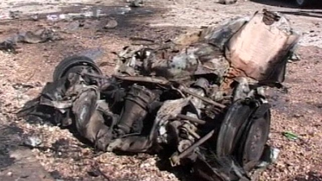 Burnt-out engine and seat after car bomb attack in Ramadi