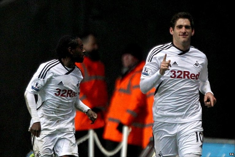 Swansea City's Danny Graham (right) celebrates with team-mate Nathan Dyer after scoring his side's third goal of the game