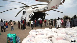 In this photo of Thursday, 12 January, 2012 relief food of the World Food Program is offloaded in Pibor, South Sudan.