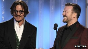 Ricky Gervais (right) with Johnny Depp