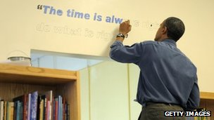 US President Barack Obama paints a Martin Luther King quote onto the wall of a school library 16 January 2012